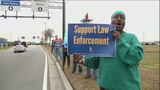 Federal workers protest government shutdown at airport