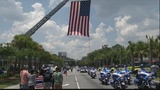 Hundreds lined the street to watch Sgt. Kelvin Ansari's funeral procession